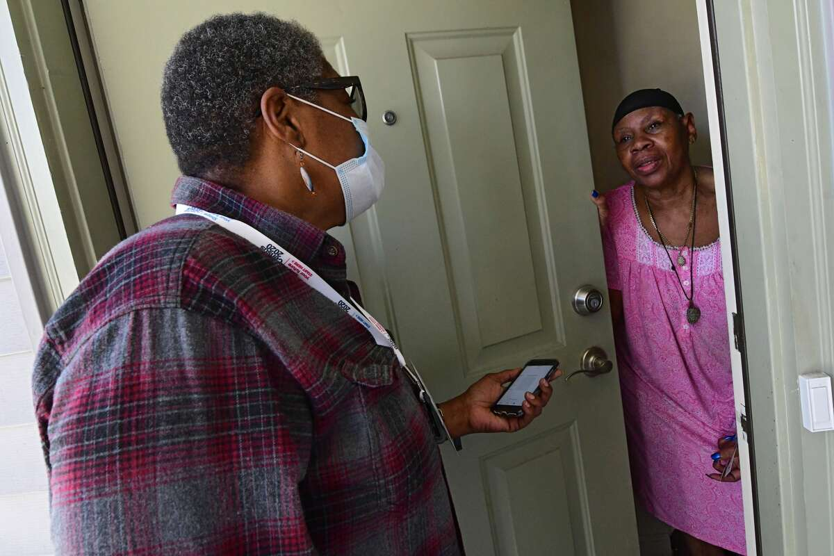 Capital District Latinos census outreach worker Cessie Alfonso asks Arbor Hill resident Essie Goodlett if she has completed her census form on Wednesday, Sept. 30, 2020 in Albany, N.Y. (Lori Van Buren/Times Union)