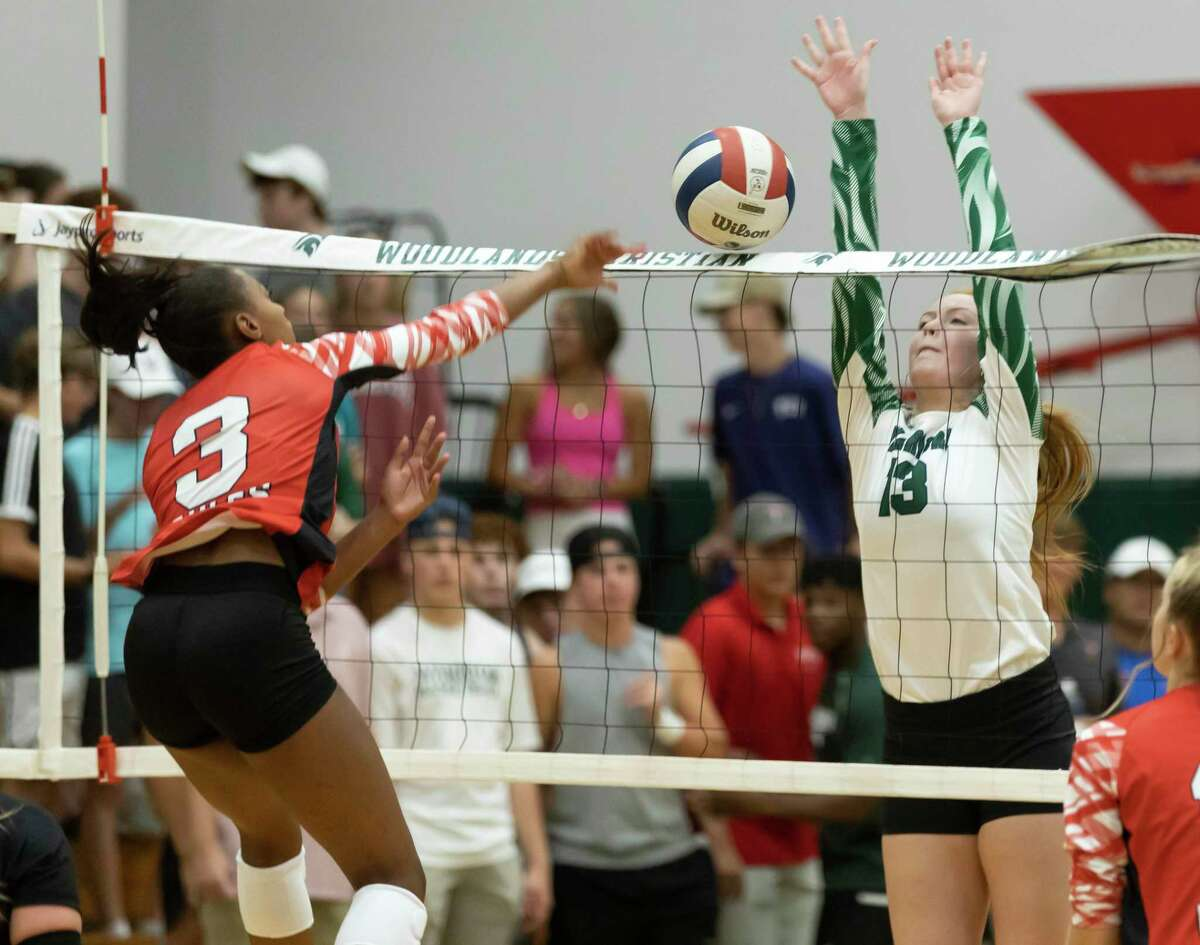 The Woodlands Christian Academy rightside hitter Ashley Darilek (3) blocks a spike from Rosehill's Kaleigh Frazier (3) during the second set of a non-district volleyball match at The Woodlands Christian Academy, Tuesday, Aug. 10, 2021, in The Woodlands.