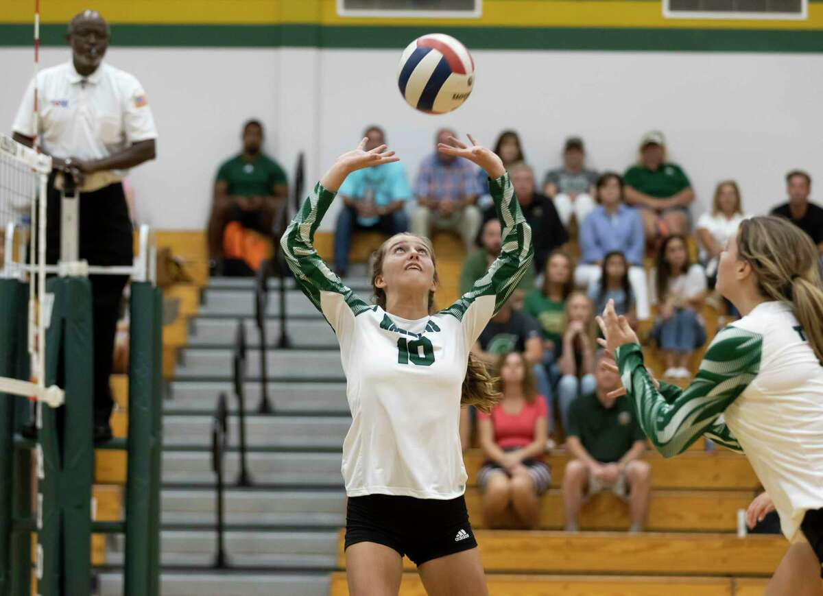 The Woodlands Christian Academy setter Addie Buck (10) prepares the ball for a play during the first set of a non-district volleyball match against Rosehill Christian School at The Woodlands Christian Academy, Tuesday, Aug. 10, 2021, in The Woodlands.