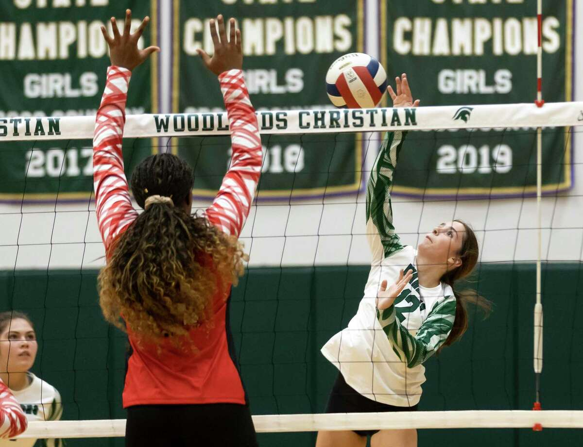 The Woodlands Christian Academy opposite hitter Katie Holloway (12) returns the ball during the first set of a non-district volleyball match against Rosehill Christian School at The Woodlands Christian Academy, Tuesday, Aug. 10, 2021, in The Woodlands.