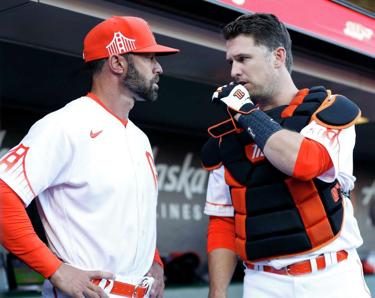 San Francisco Giants' manager Gabe Kapler and Buster Posey before game against Los Angeles Dodgers at Oracle Park in San Francisco, Calif., on Monday, July 27, 2021.