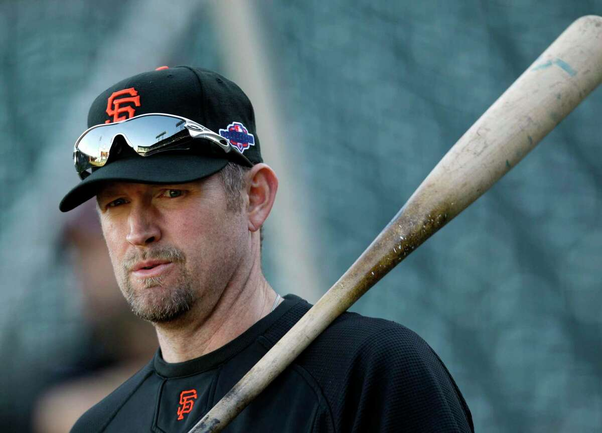 San Francisco Giants first baseman Aubrey Huff warms up before Game 2 of the National League division baseball series against the Cincinnati Reds in San Francisco, Sunday, Oct. 7, 2012. (AP Photo/Eric Risberg)