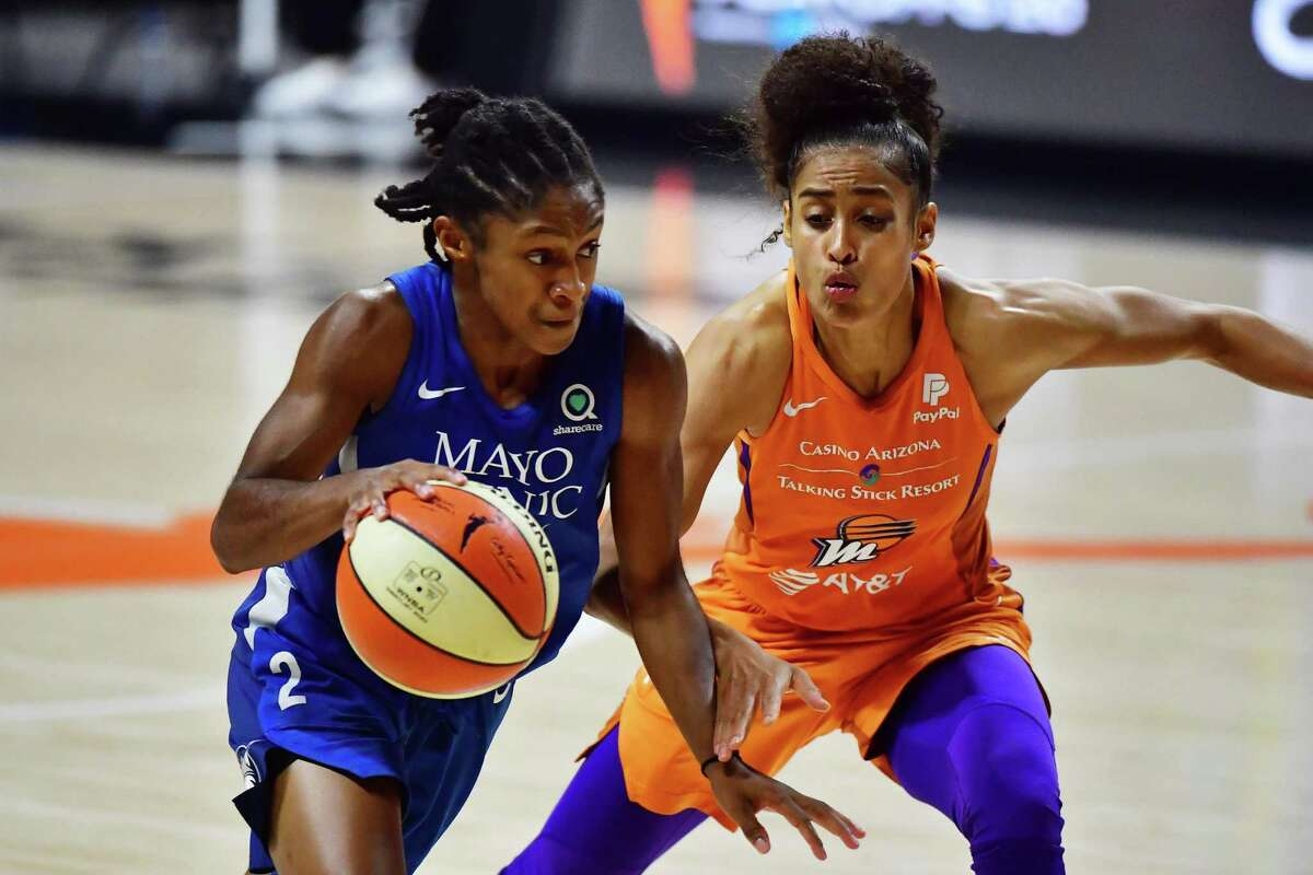 The Minnesota Lynx's Crystal Dangerfield, left, drives against Skylar Diggins-Smith of the Phoenix Mercury in Game 1 of a second-round playoff series at Feld Entertainment Center in Palmetto, Florida, on September 17, 2020.