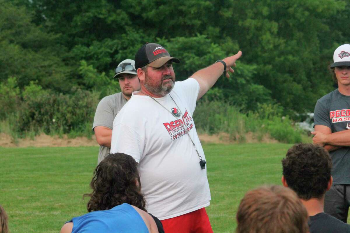 Reed City football coach Scott Shankel issues instructions to his players after a recent practice. (Pioneer photo/John Raffel)