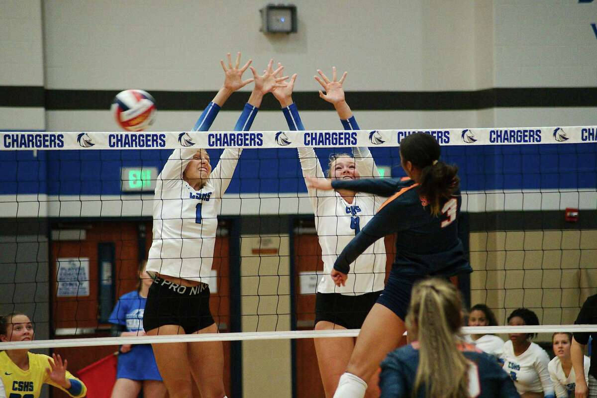 Clear Springs' Kaitlyn Johnson (1) and Arion Keeton (9) team up to try to block Katy Seven Lakes' LeAnna Beaty (3) Tuesday at Clear Springs High School.