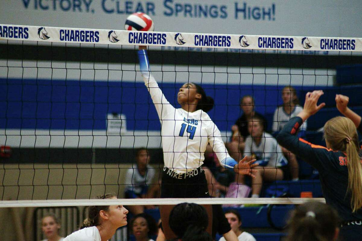 Clear Springs' Grace King (14) tries to score a point against Seven Lakes Tuesday at Clear Springs High School.