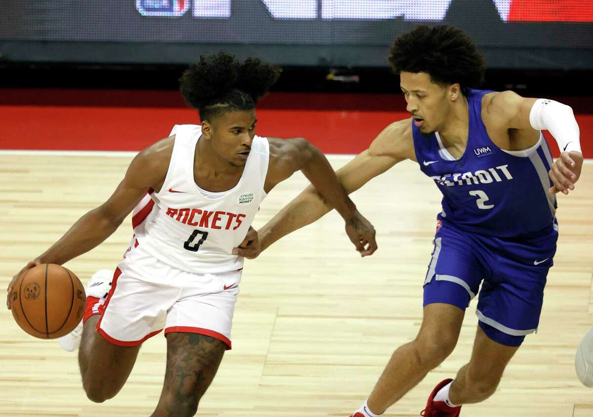 LAS VEGAS, NEVADA - AUGUST 10: Jalen Green #0 of the Houston Rockets drives against Cade Cunningham #2 of the Detroit Pistons during the 2021 NBA Summer League at the Thomas & Mack Center on August 10, 2021 in Las Vegas, Nevada.