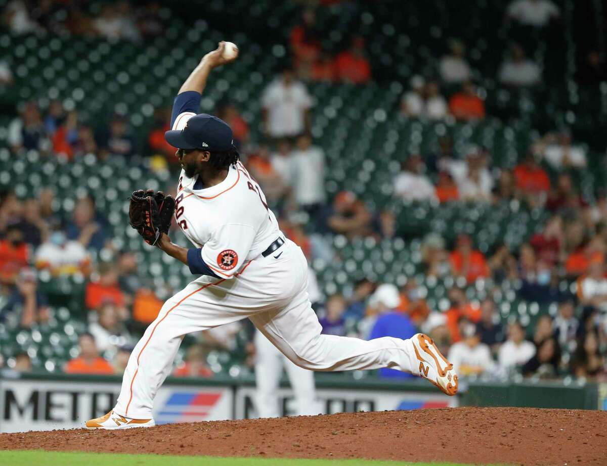 Houston Astros Pedro Baez pitches during the ninth inning of an MLB baseball game at Minute Maid Park, Tuesday, August 10, 2021, in Houston.