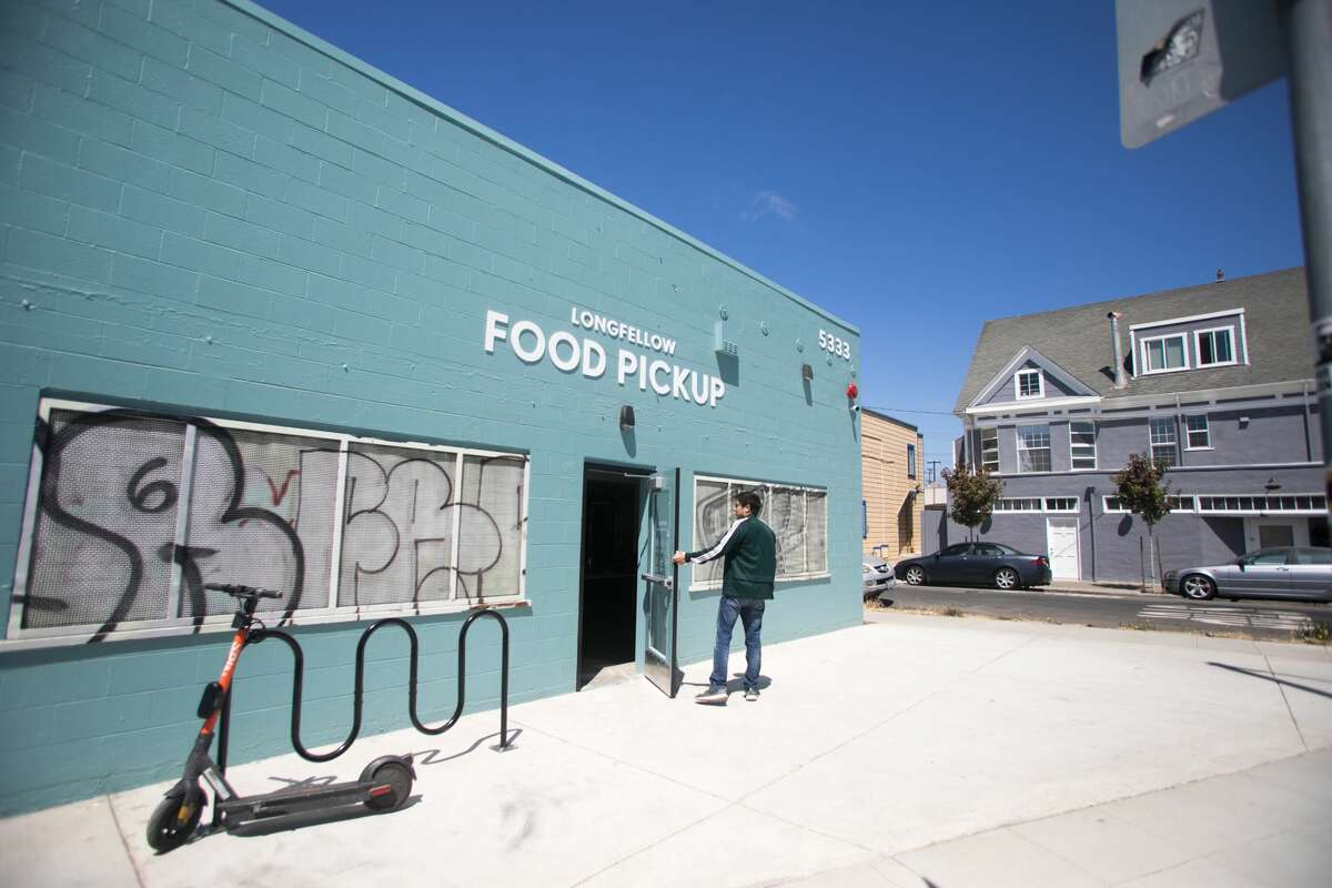 """The exterior of Longfellow Food Pickup at 5325 Adeline St. in Oakland, Calif., on July 30, 2021. It is a """"ghost kitchen"""" facility that houses multiple different commercial kitchens that make takeout orders for customers. Nearby residents are concerned about a potential increase in traffic from customers and food delivery services."""