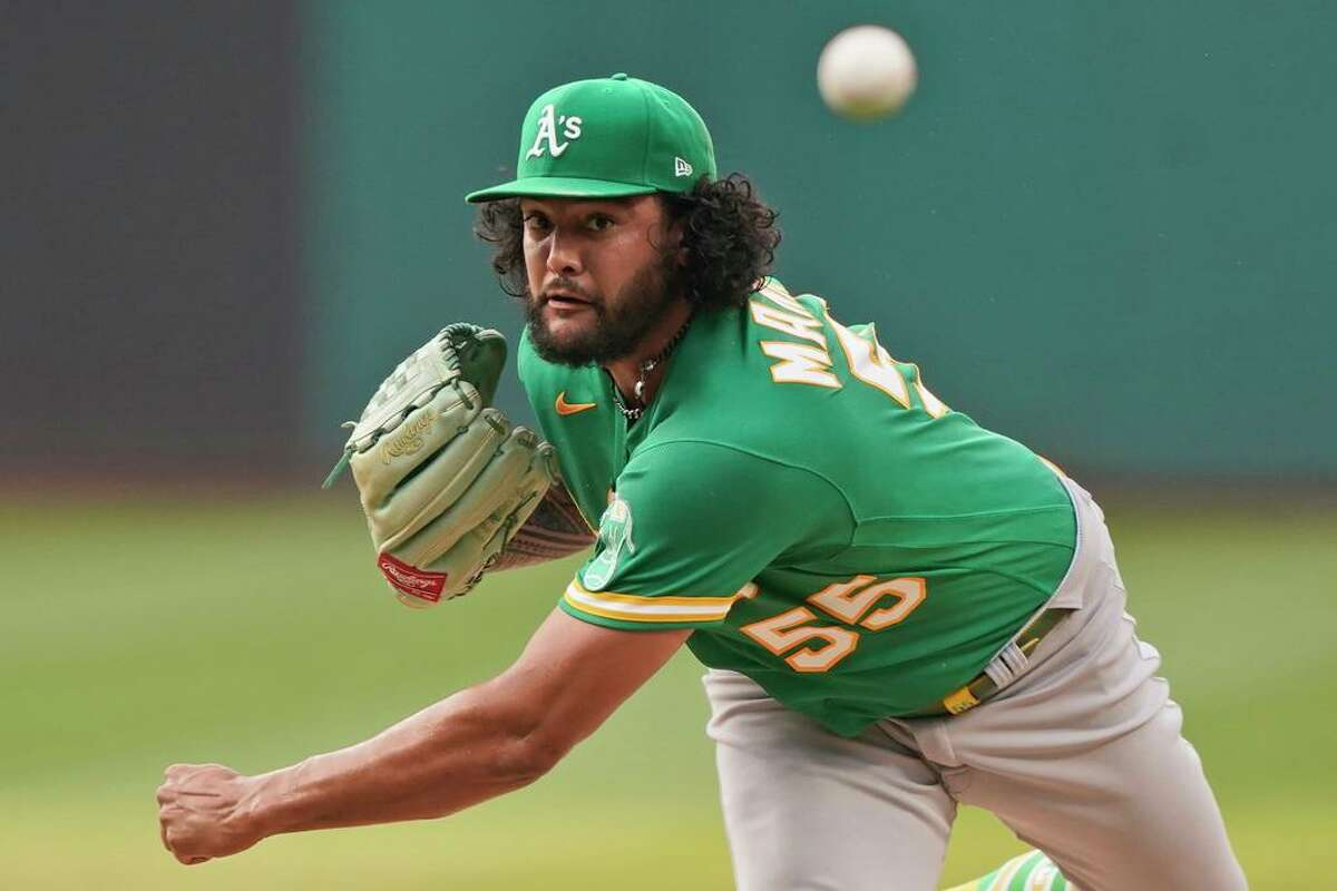 Oakland Athletics starting pitcher Sean Manaea delivers in the first inning of a baseball game against the Cleveland Indians, Tuesday, Aug. 10, 2021, in Cleveland. (AP Photo/Tony Dejak)