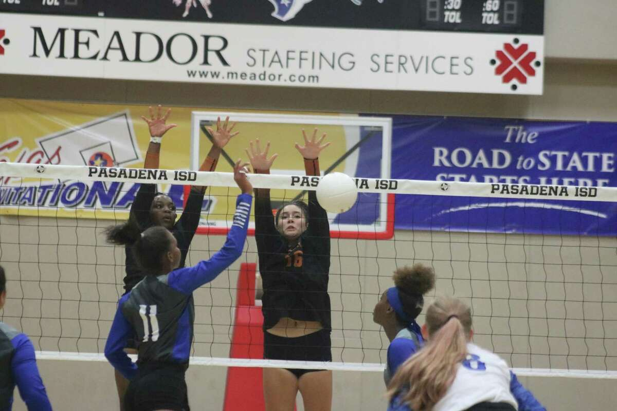 Dobie's Haley DeHoyos (16) knocks down a Sterling kill attempt for game point and a new lead of 2-1 in Tuesday night's match at Phillips Field House. Tanishua Joseph is the Sterling player (11).
