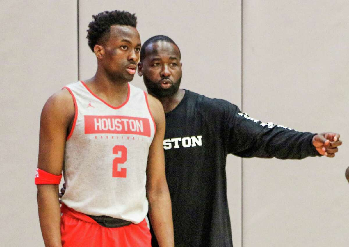 In his first year as director of player development for the University of Houston basketball team, former Cougars star Anthony Goldwire offers instruction to freshman guard Robbie Armbrester (2).