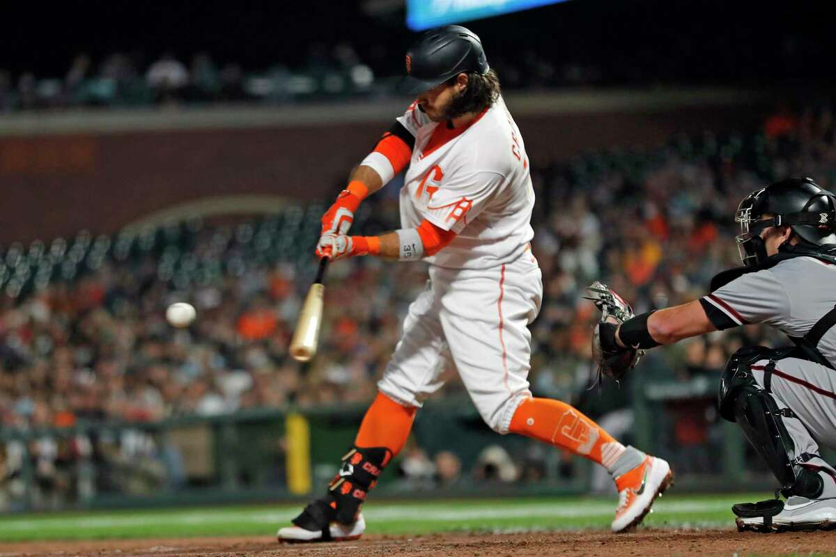 San Francisco Giants' Brandon Crawford hits a go-ahead RBI double in 8th inning against Arizona Diamondbacks during MLB game at Oracle Park in San Francisco, Calif., on Tuesday, August 10, 2021.