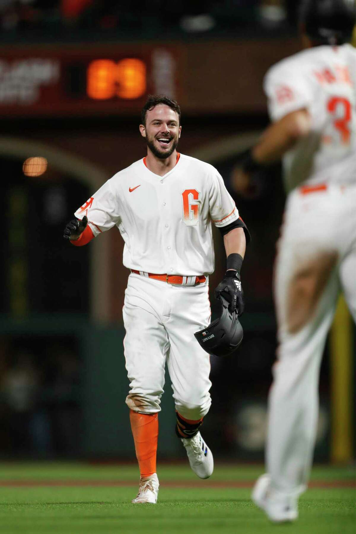 San Francisco Giants' Kris Bryant celebrates after the Arizona Diamondbacks' Christian Walker committed an error giving the Giants an 8-7 win in MLB game at Oracle Park in San Francisco, Calif., on Tuesday, August 10, 2021.