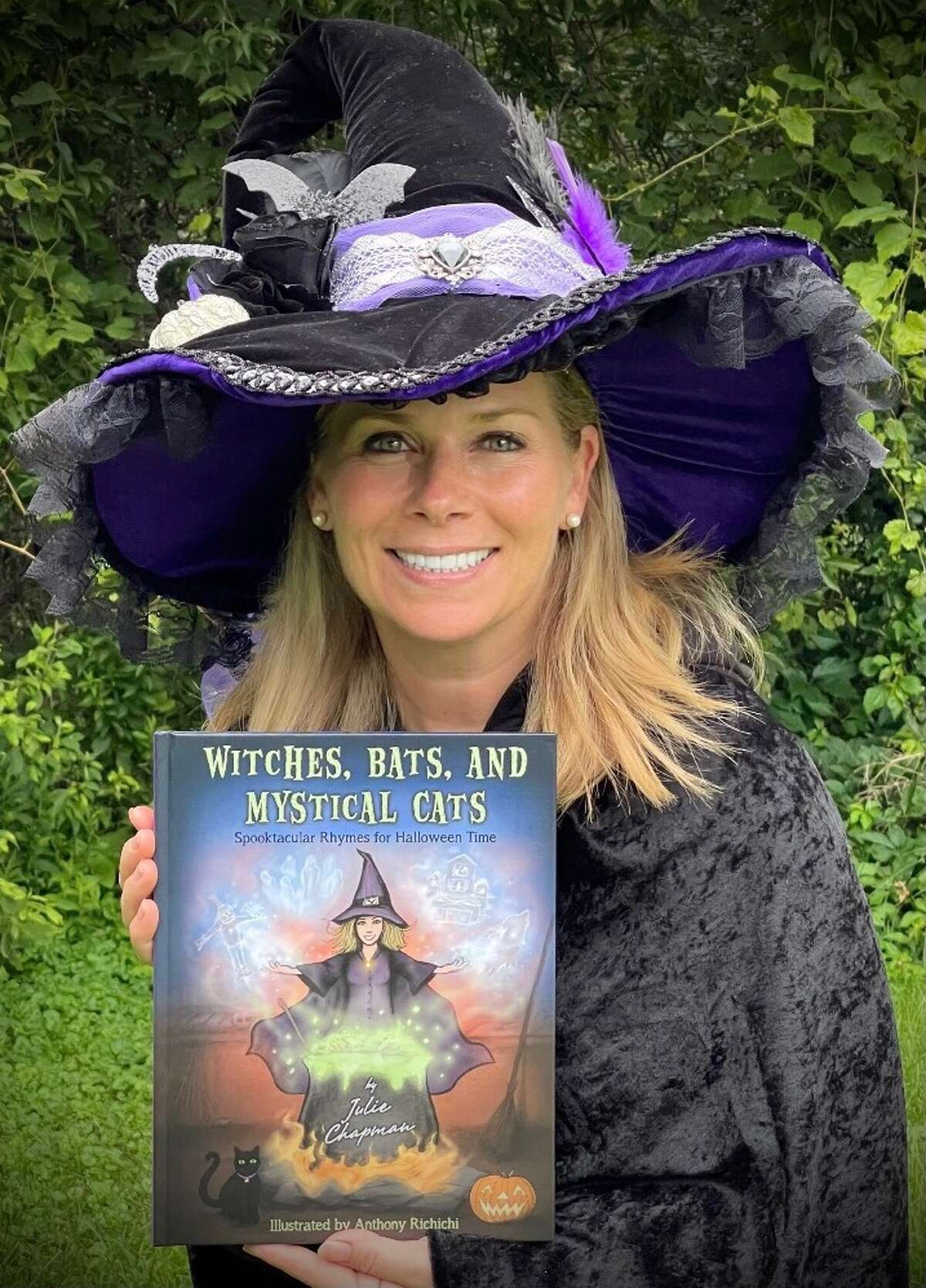 """Julie Chapman has published her first book, """"Witches, Bats, and Mystical Cats - Spooktacular Rhymes for Halloween Time."""" The first shipment sold out in a week at Barnes & Noble in Colonie Center."""