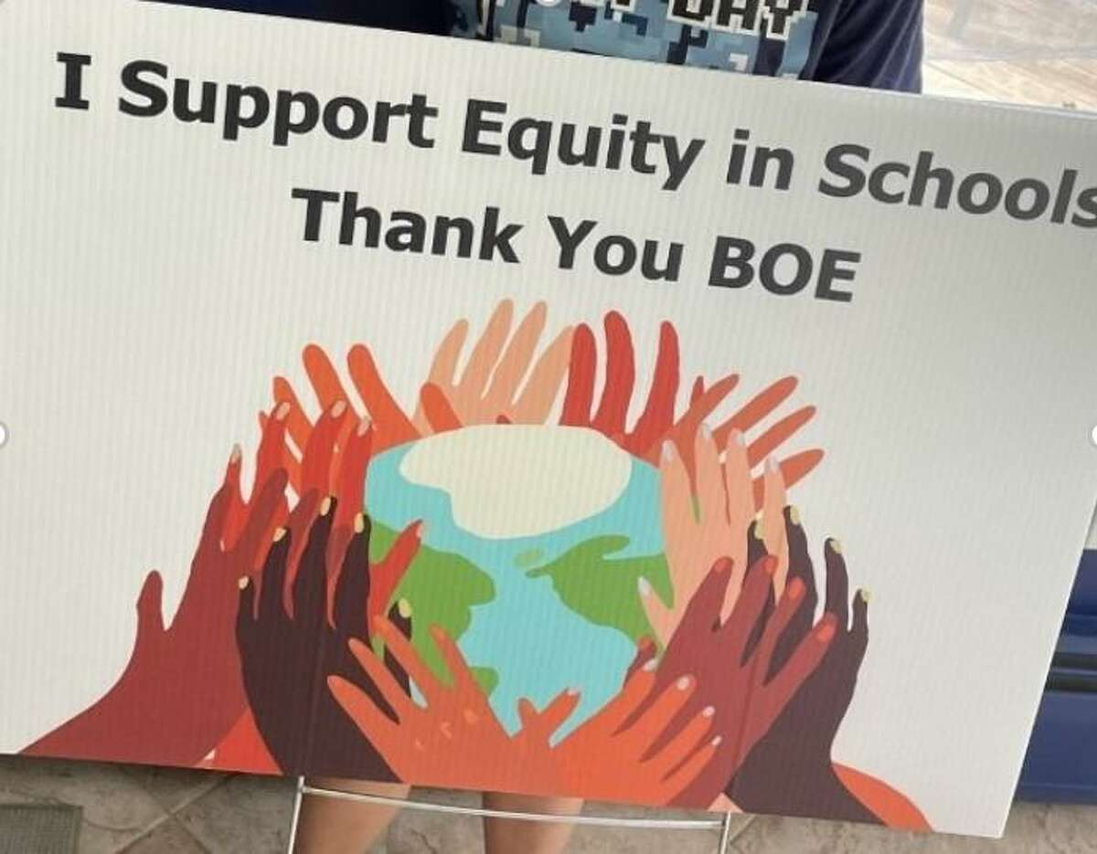 A sign shows support for the Guilford Board of Education.