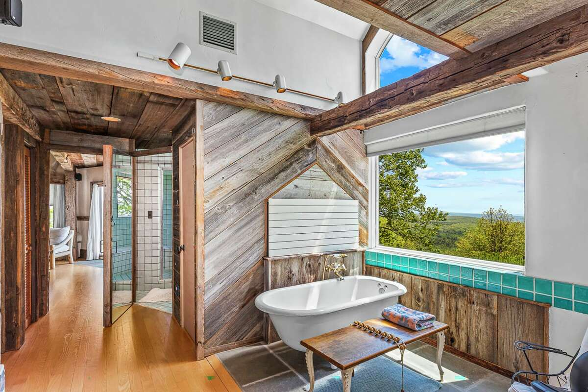 There are a total of 4.5 baths, including one with a steam shower and the other with a solid piece of bluestone as its door.