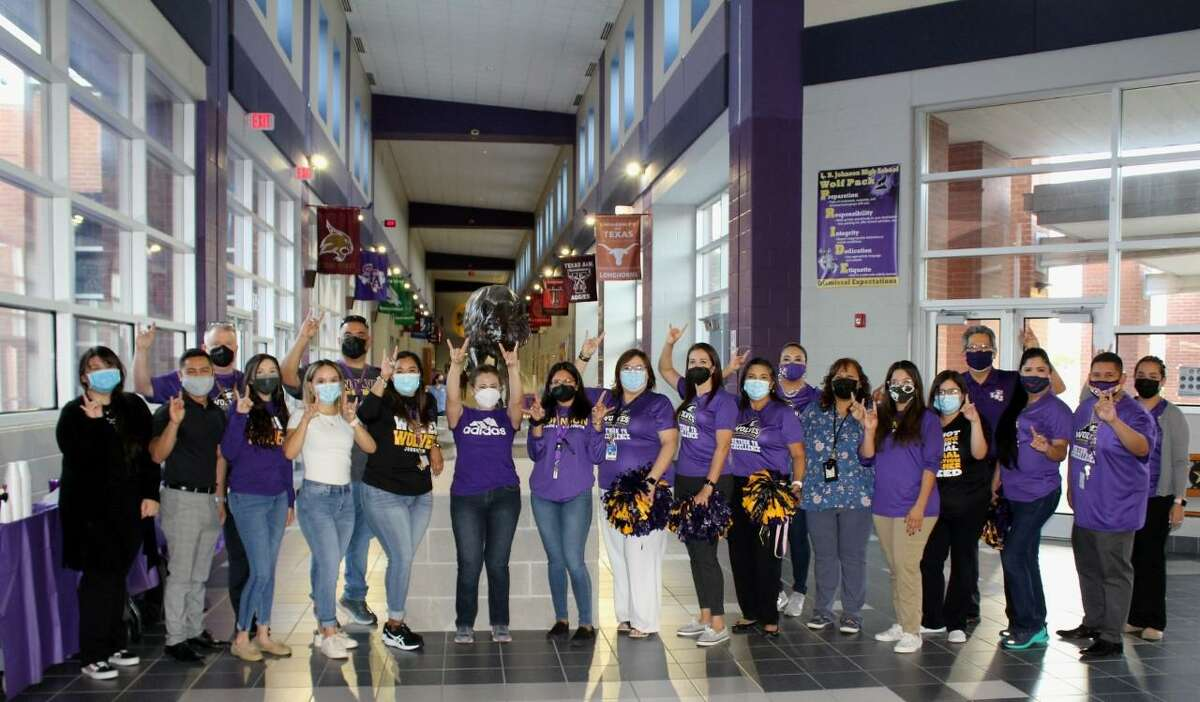 Teachers are pictured in the hallway at Lyndon B. Johnson High School.