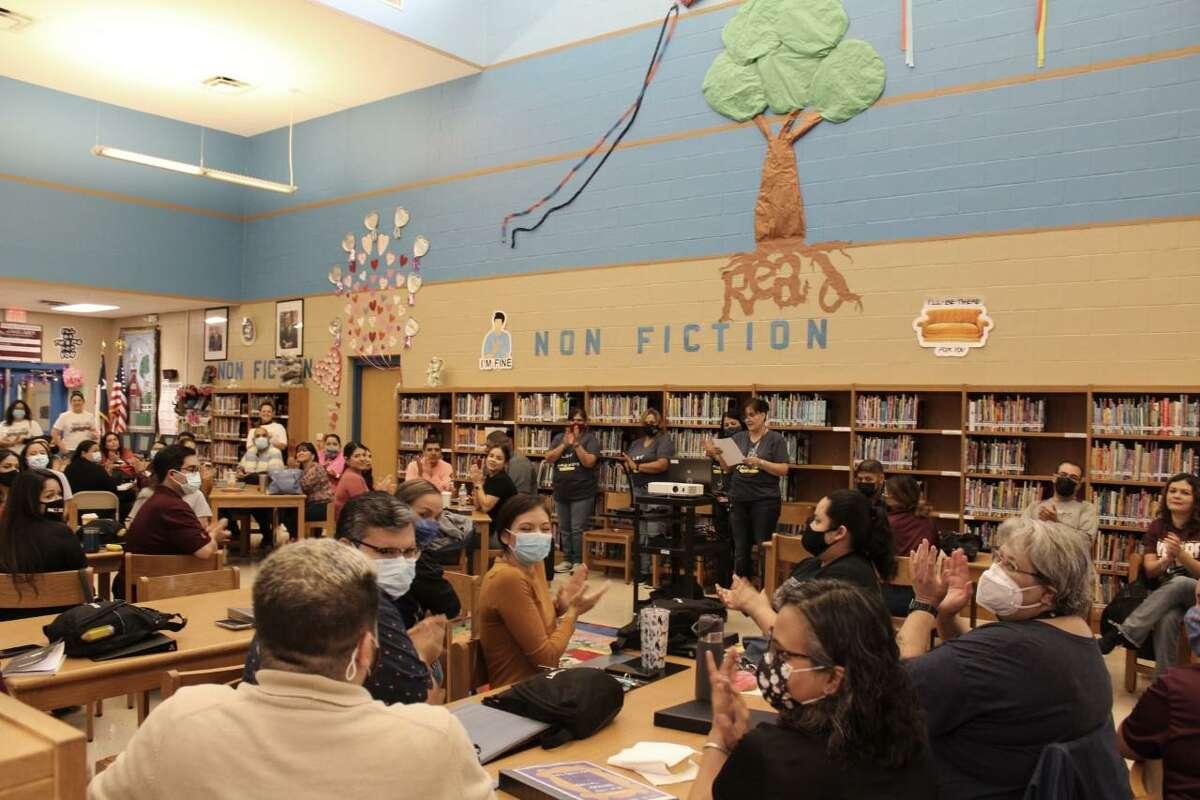 Teachers gather in the library at Lamar Bruni Vergara Middle School.