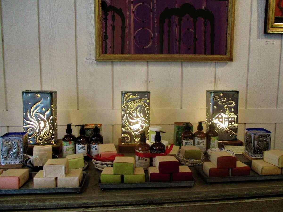 Elizabeth Wolff's pierced tin lanterns amongst homemade soaps.