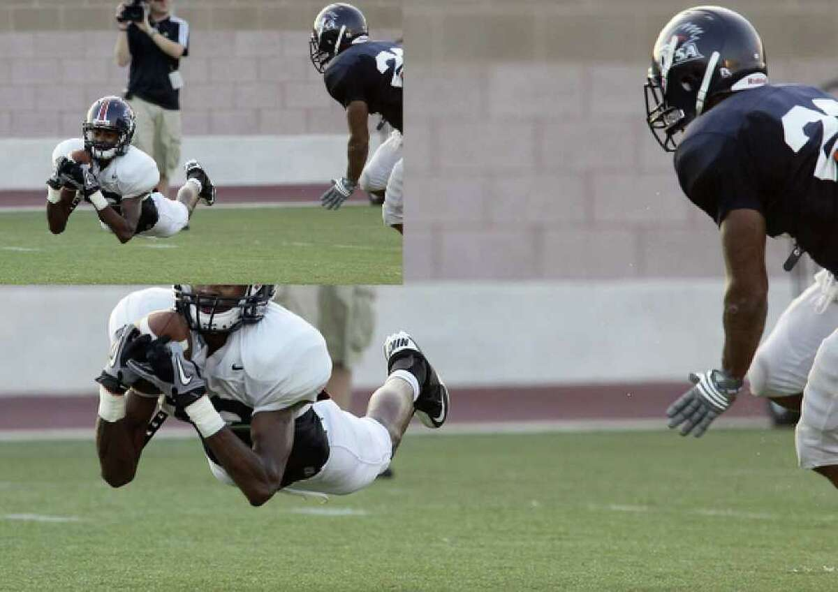 Freshman wide receiver Earon Holmes (left) makes a diving catch.