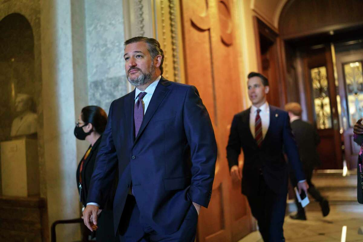 Sen. Ted Cruz, R-Texas, followed by Sen. Josh Hawley, R-Mo., leaves the chamber during the non-stop voting session on President Joe Biden's top domestic policy ambitions, at the Capitol in Washington, Tuesday, Aug. 10, 2021. Early Wednesday, Aug. 11, 2021, Sen. Cruz blocked the quick confirmation of dozens of Biden's State Department nominees, guaranteeing that they will stay sidelined until next month when the Senate returns from its summer break. (AP Photo/J. Scott Applewhite)