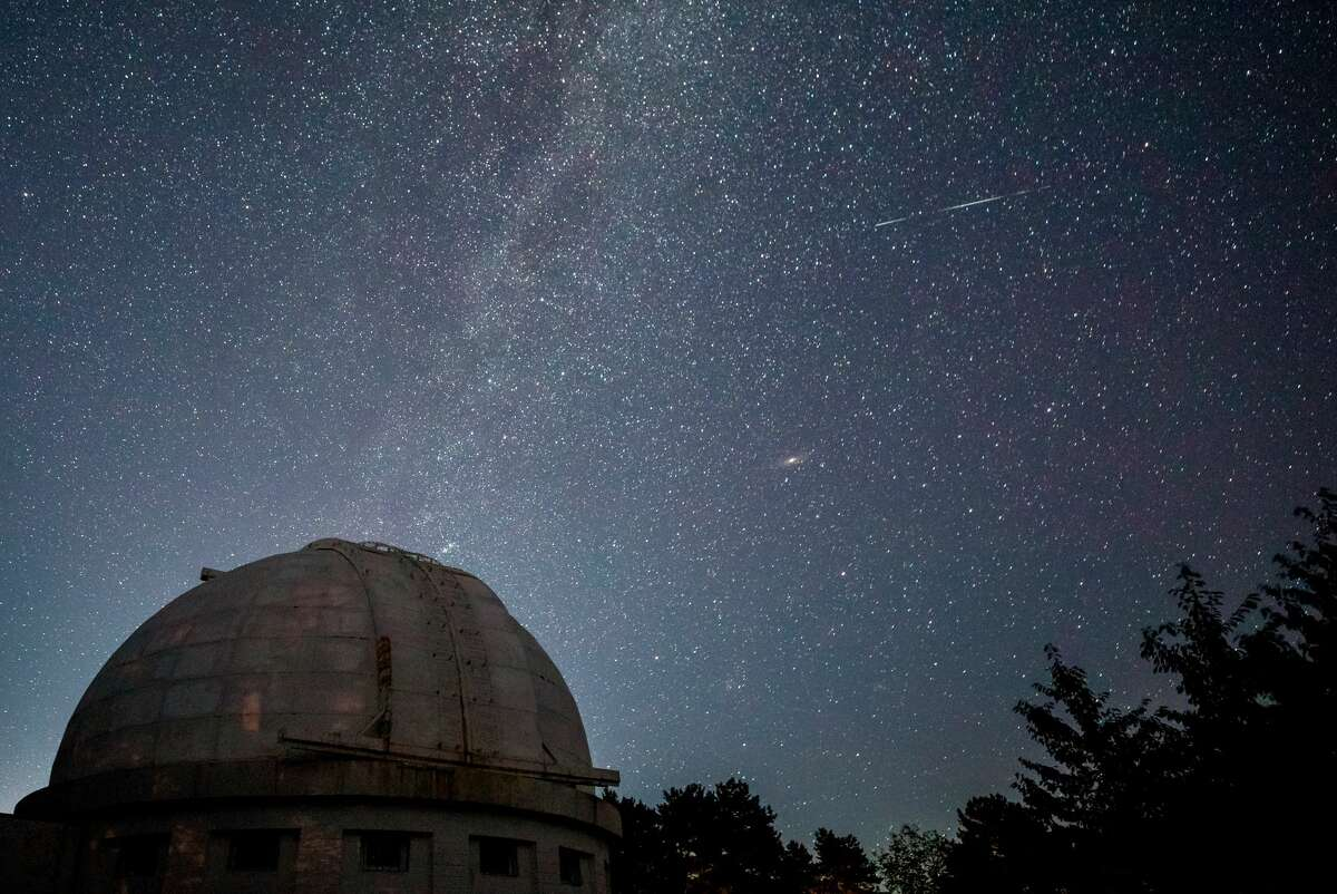 The Milky Way along with traces of the passing Perseid meteor shower visible in the sky over a solar tower of the Crimean Astrophysical Observatory under the Russian Academy of Sciences, located in the village of Nauchny, Bakhchisaray District, southwestern Crimea.