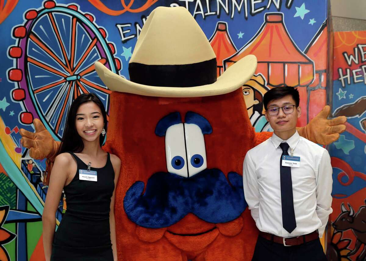 Khan Nguyen, the Houston Rodeo mascot and Dominic Trinh at the Houston Livestock Show and Rodeo Scholarship Banquet at the NRG Center Wednesday, May. 22, 2019 in Houston, TX.