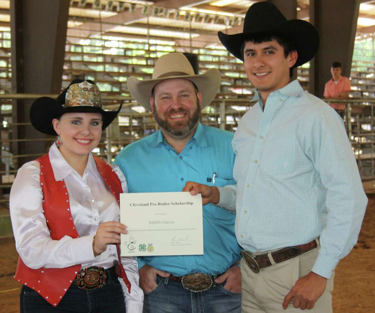 Adolfo Garcia, a Cleveland High School graduate and Sam Houston State University student, accepts a $1,500 Cleveland Pro Rodeo scholarship from this year's rodeo queen Cheyanne Barrett and Cleveland Pro Rodeo President Chance Ward at the April 27 Cleveland Livestock Show buyers dinner at Stancil Exposition Center.