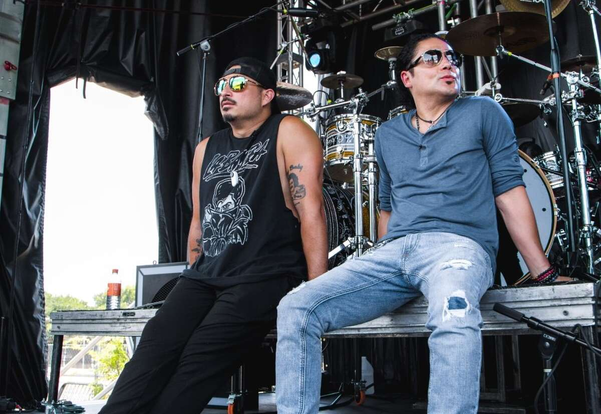 """Chris Perez (right), the former Selena y Los Dinos guitarist who was married to the beloved frontwoman at the time of her death, is launching BlueMariachi Productions. Carlton Zeus (right), who performs as """"ZEUS. El Mero Necio,"""" is the first signee on the label, according to an announcement."""