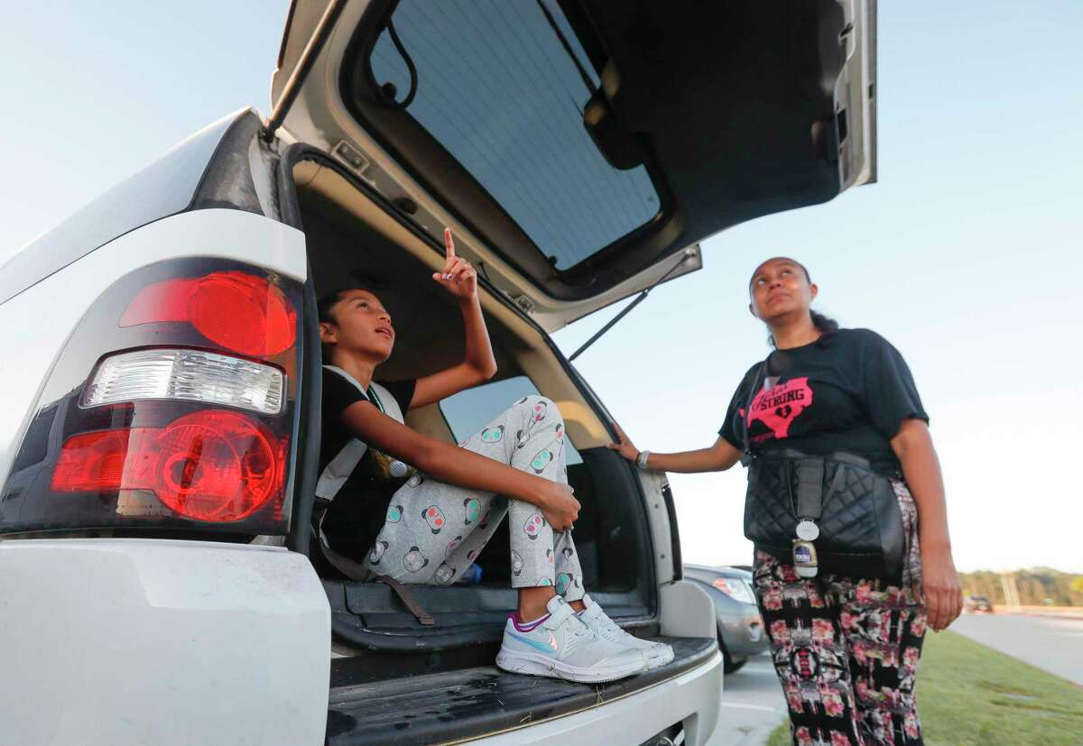 Zoey Gonzalez, left, points out airplanes to her mother, Maria, before the first day of school at Conroe ISD's new Hope Elementary, Wednesday, Aug. 11, 2021, in Grangerland.