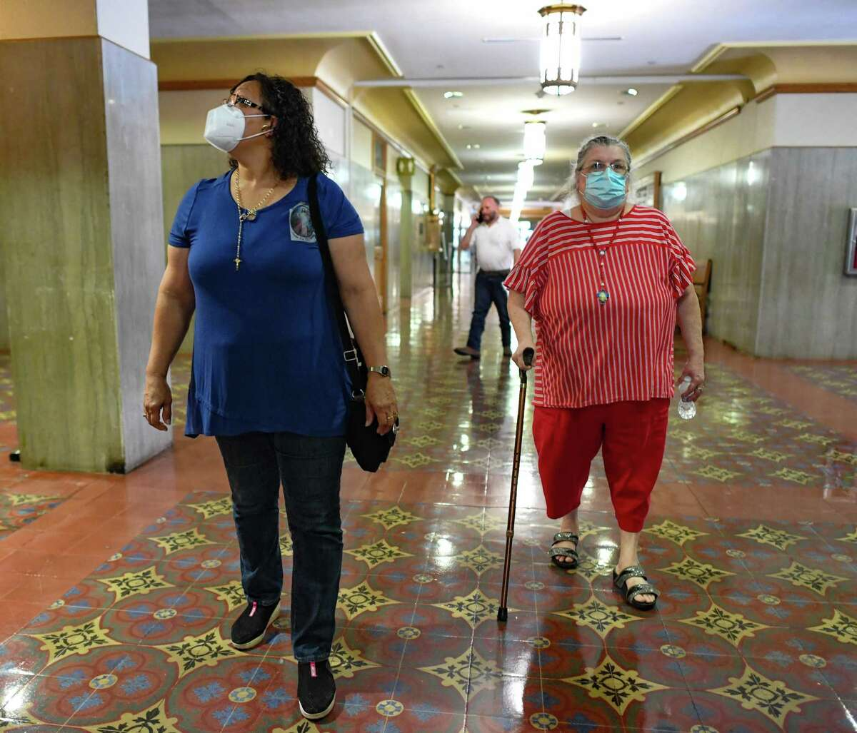 """Elsa Nieves, left, and Maria Sartor wear masks in the Bexar County Courthouse on Tuesday, Aug. 10, 2021. """"You have to be out of your mind to not wear one,"""" Sartor said. A new executive order from County Judge Nelson Wolff requires all people in Bexar County facilities to do likewise."""