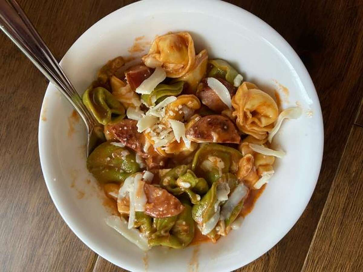 Sausage and tortellini dish is a one-skillet meal packed with cheese and crunchy peppers.