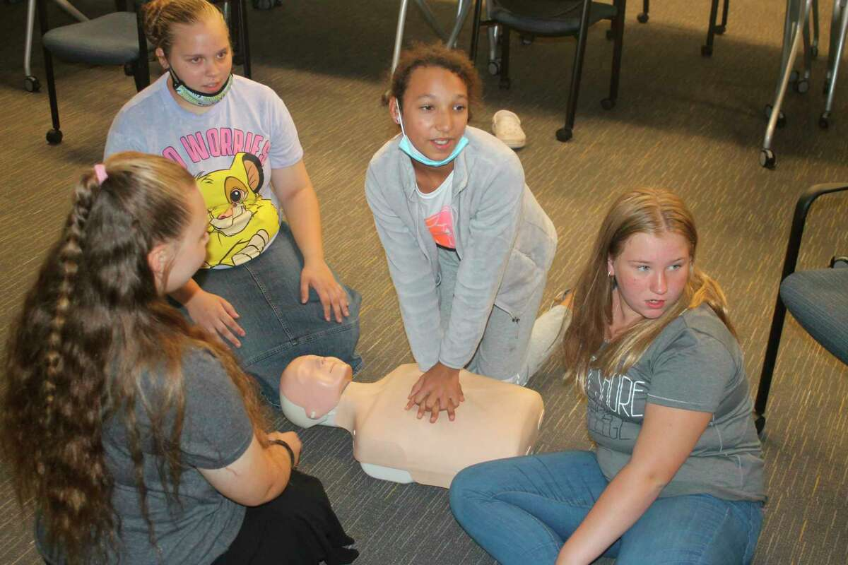 Students practice CPRon Aug. 6 in the Babysitting Basics class offered as part of West Shore Community College's College for Kids program. (Kyle Kotecki/News Advocate)