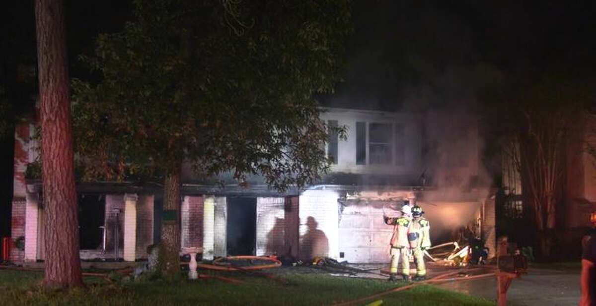 Arson investigators on the scene of a deadly fire at a home in Kingwood.