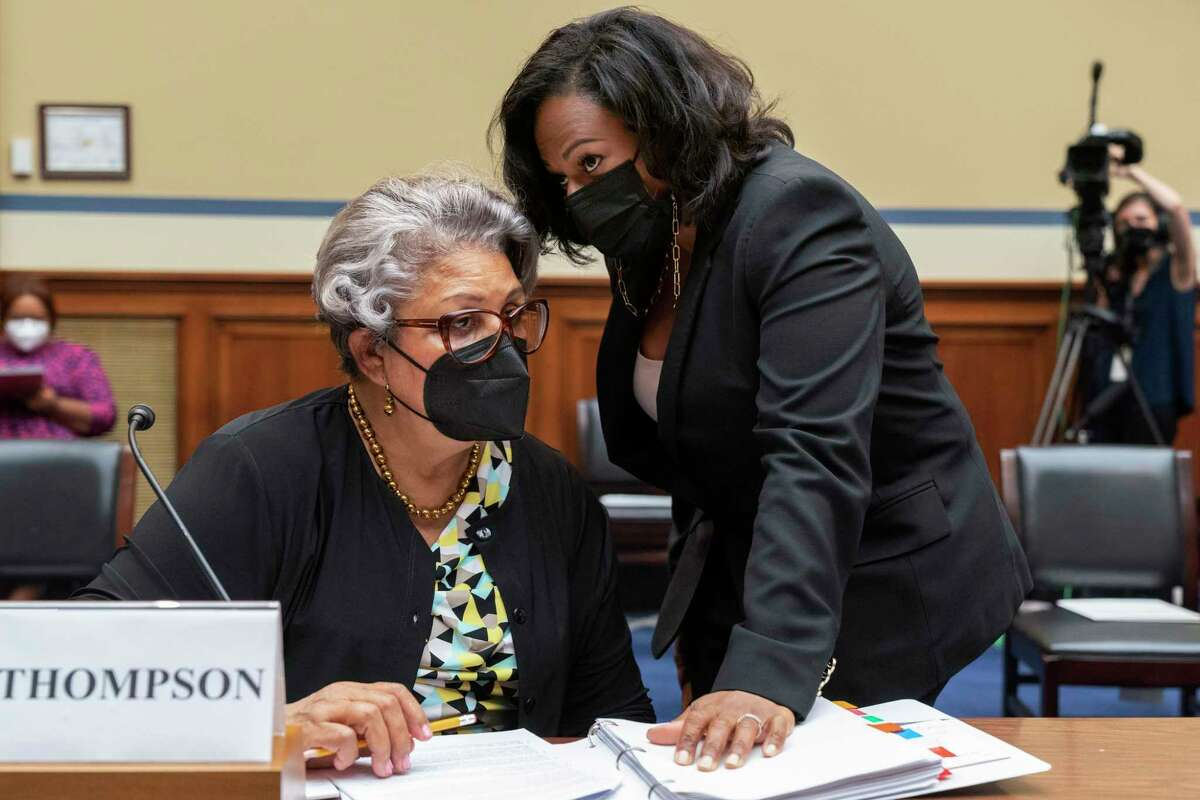 Texas State Democratic Representatives Senfronia Thompson, left, listens to Texas state Rep. Nicole Collier, who is also the chair of the Texas Legislative Black Caucus, as they take their places to testify at a House Committee on Oversight and Reform hearing about voting rights in Texas, Thursday, July 29, 2021, on Capitol Hill in Washington.