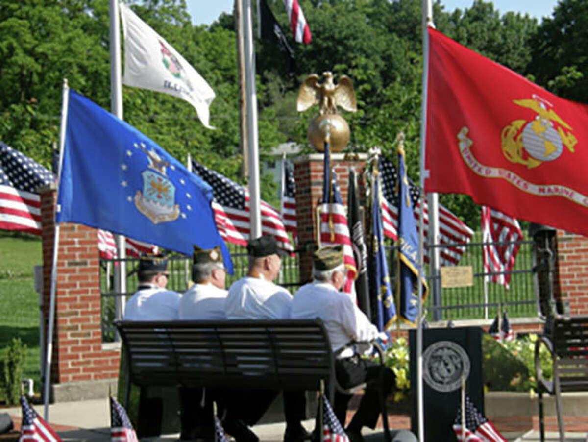 Members of Glen Carbon American Legion Post 435 commemorate Memorial Day 2016 at the Glen Carbon Veterans Monument.