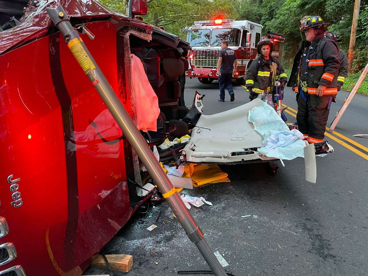 Fire crews working the scene of a rollover in Fairfield, Conn., on Tuesday, Aug. 10, 2021.