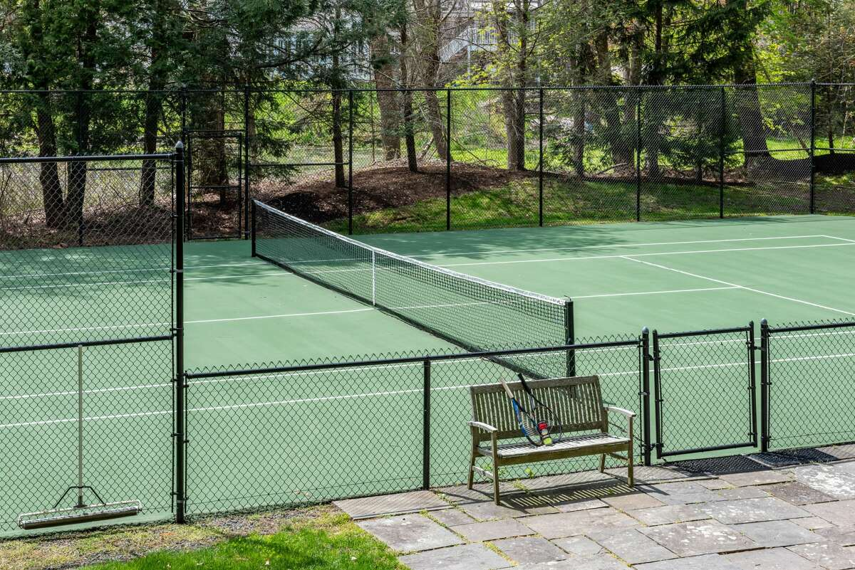 """The home alsohas a """"championship tennis court"""" on its 3 acres of land."""