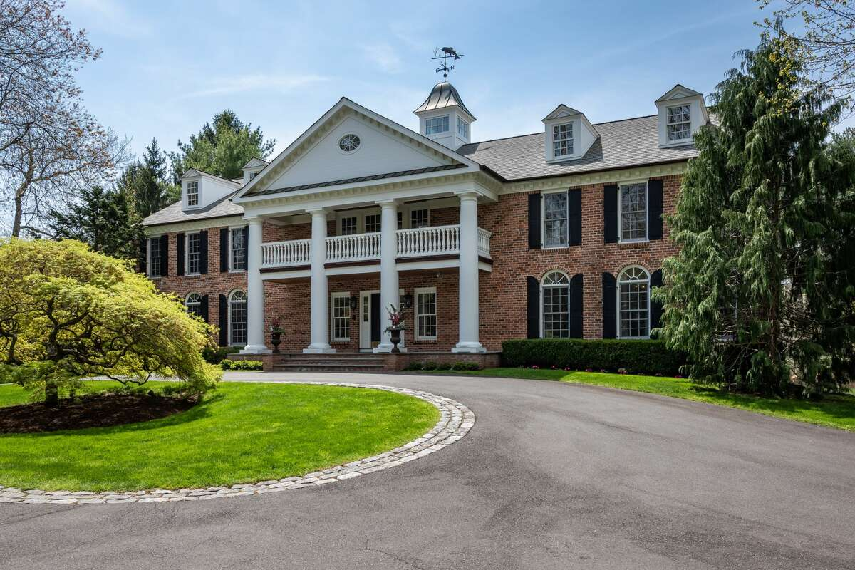 The home on 123 Hemlock Hill Road in New Canaan, Conn. has 9,700 square feet of living space, five en-suite bedrooms and several levels of outdoor living space.