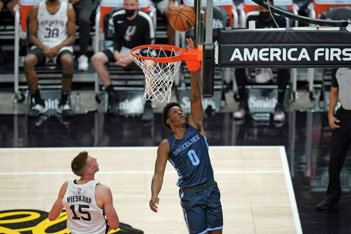 Memphis Grizzlies forward Romeo Weems (0) goes to the basket as San Antonio Spurs guard Joe Wieskamp (15) looks on in the first half during an NBA summer league basketball game Friday, Aug. 6, 2021, in Salt Lake City.
