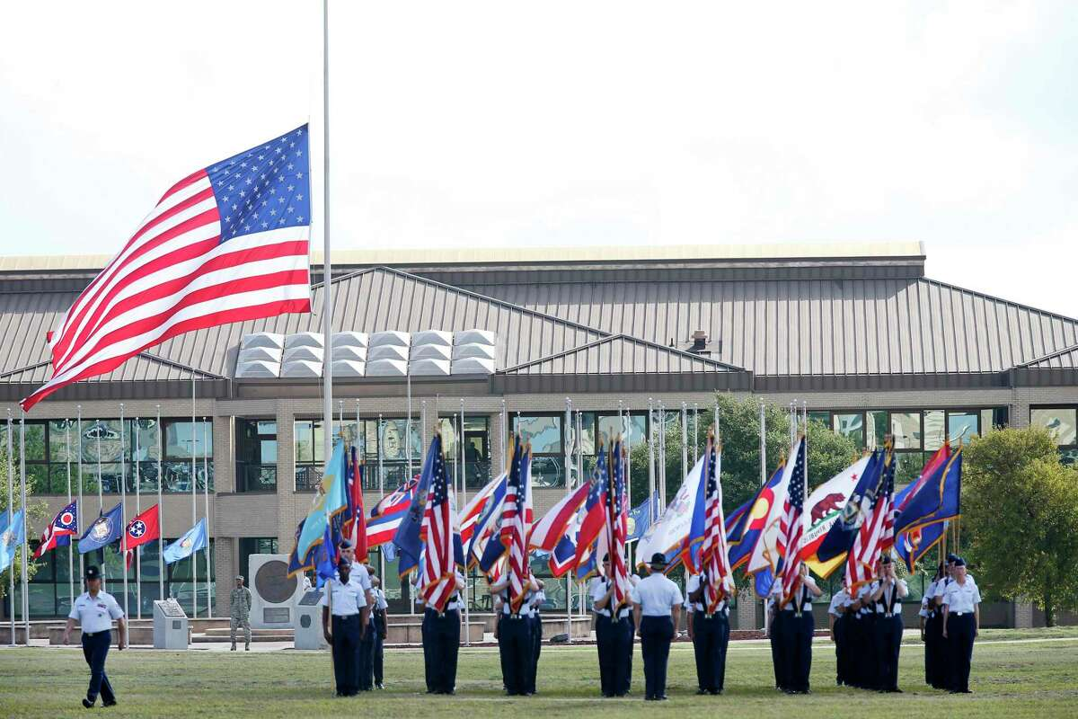 Michael Angelo Padron, the president of San Antonio-based construction company Mapco Inc., last month was denied access to Joint Base San Antonio-Lackland where he has been supervising construction contracts. He was indicted earlier this year on conspiracy to defraud the government and nine wire fraud charges. In this 2018 photo, military flags are carried by personnel during a graduation parade at the base.