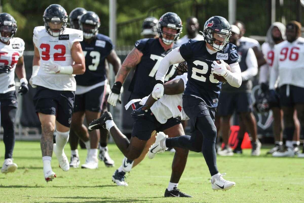 Houston Texans running back Rex Burkhead (28) runs the ball during an NFL training camp football practice Wednesday, Aug. 11, 2021, in Houston.