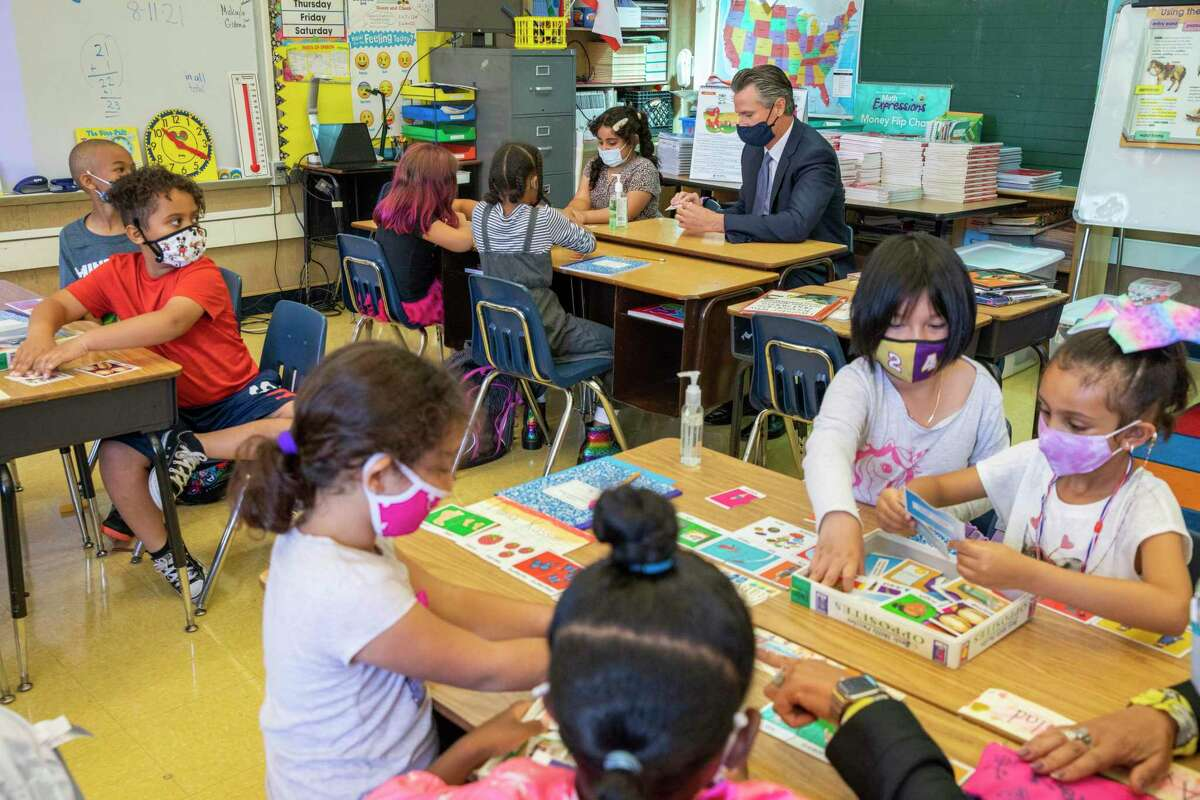 California Gov. Gavin Newsom visits Carl B. Munck Elementary School, Wednesday, Aug. 11, 2021, in Oakland, Calif. The governor announced that California will require its 600,000 teachers and school employees to be vaccinated against the novel coronavirus or submit to weekly COVID-19 testing.