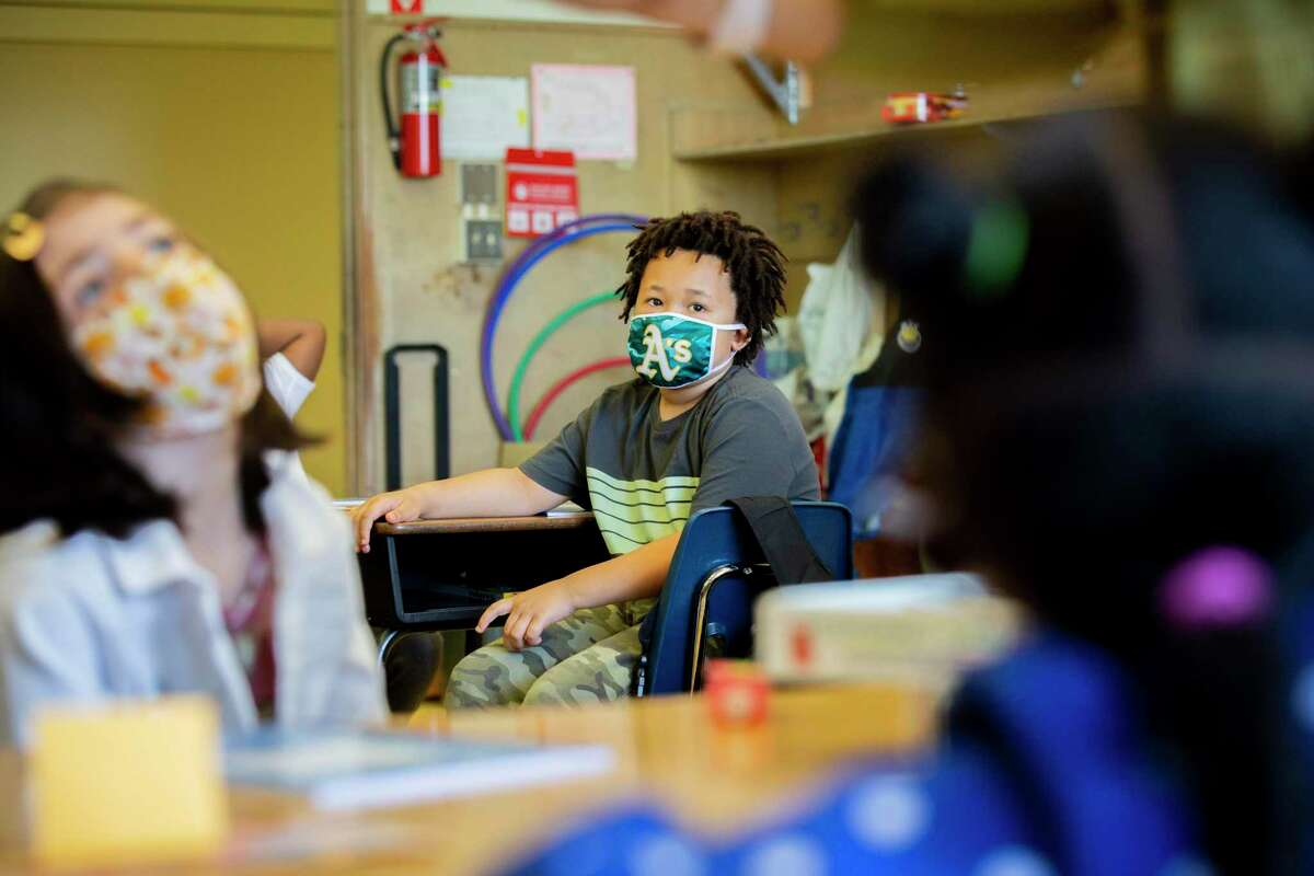 Narayana Collins sports a fan mask at Carl B. Munck Elementary in Oakland. Experts say the best mask for a child is one that a child will wear.