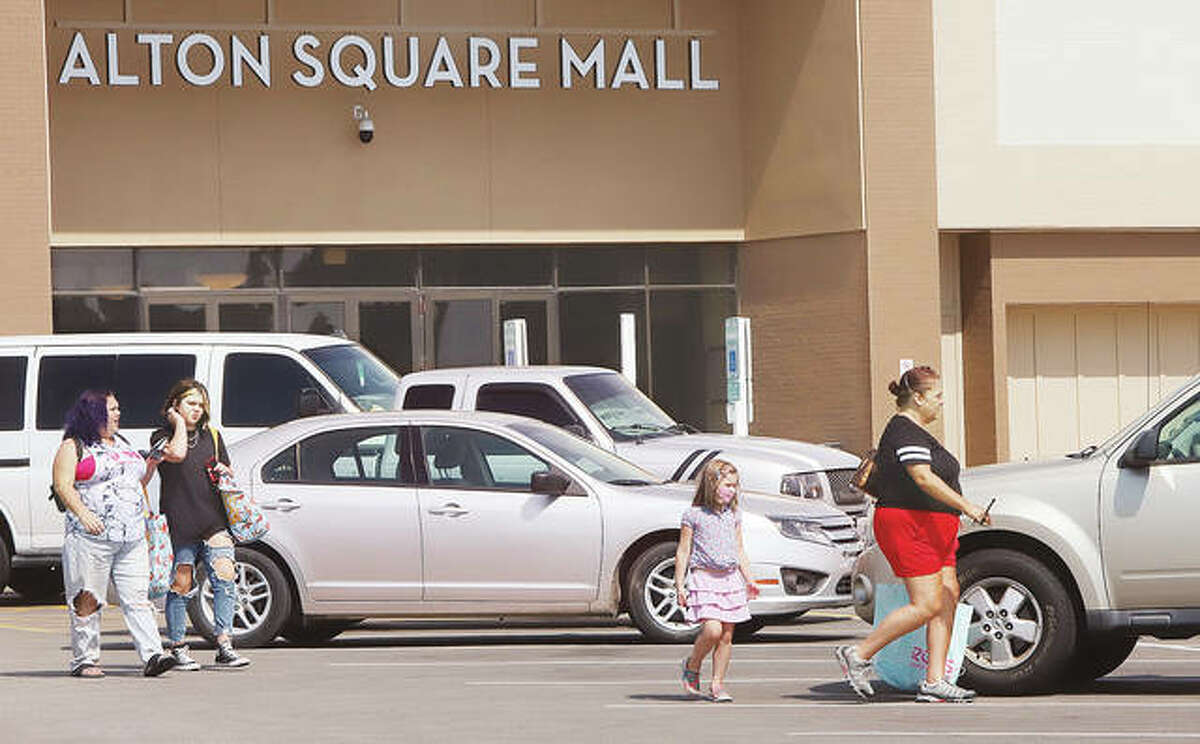 Customers head to their cars Wednesday after shopping at Alton Square Mall. Hull Property Group, which bought the mall in 2015, has been honored by the North Alton Godfrey Business Council for investing millions into improvements at the shopping center. - John Badman The Telegraph