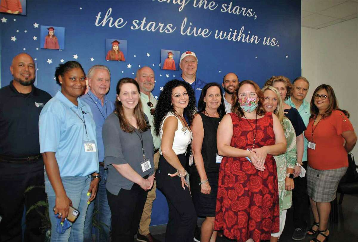 Representatives from the GHBA, Perry Homes, Taylor Morrison Homes, HomeAid WORKS, WorkTexas, Building Talent Foundation, HBI, Habitat for Humanity and HCC were at Gallery Furniture's WorkTexas facility for the Constsruction Hire Event in late July.