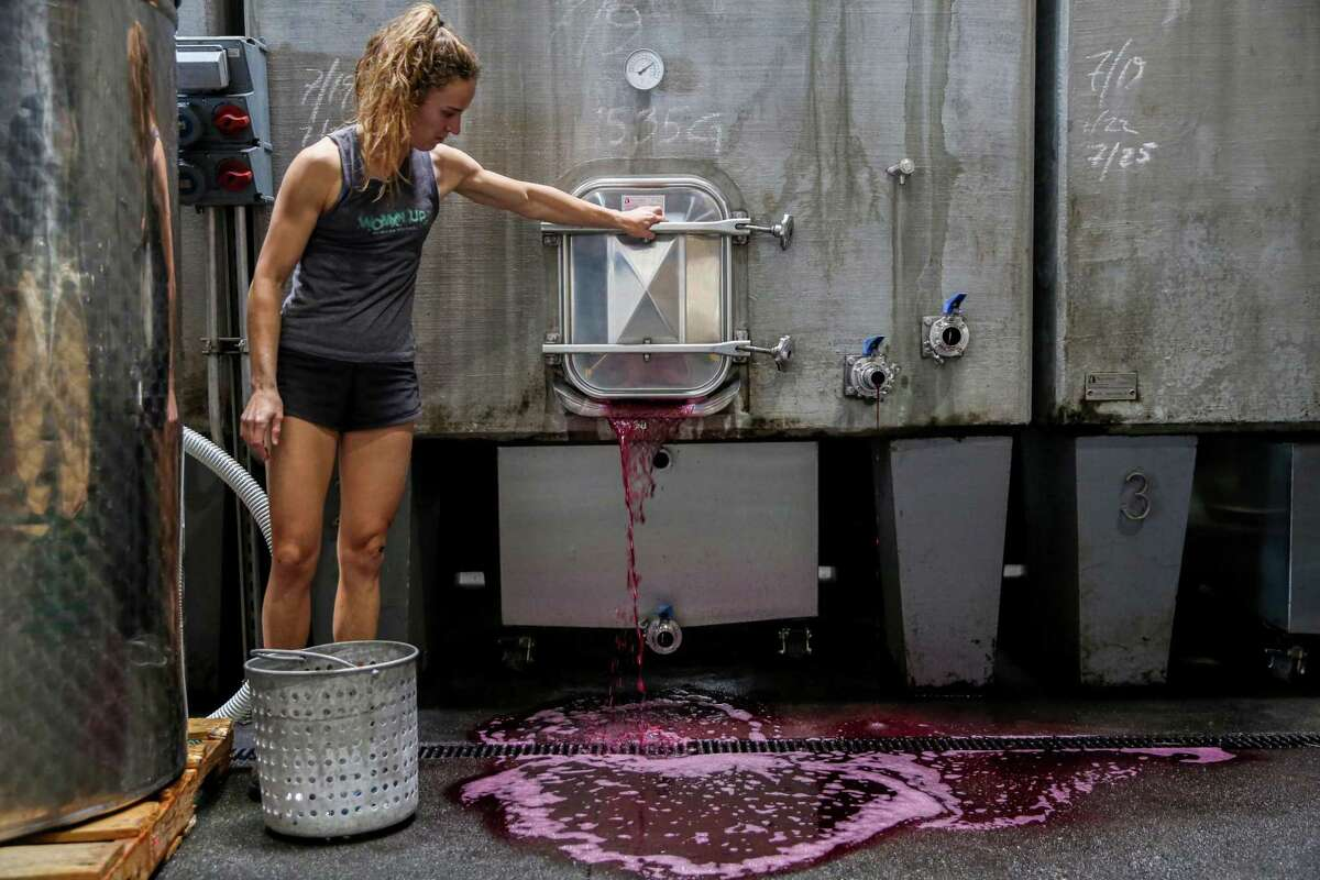 Rosalind Reynolds of Emme Wines drains a tank of wine.