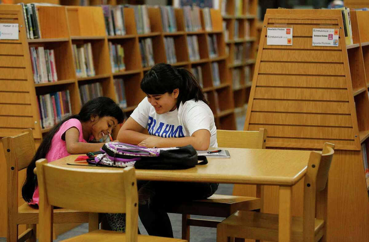 A student receives tutoring in reading and other subjects.
