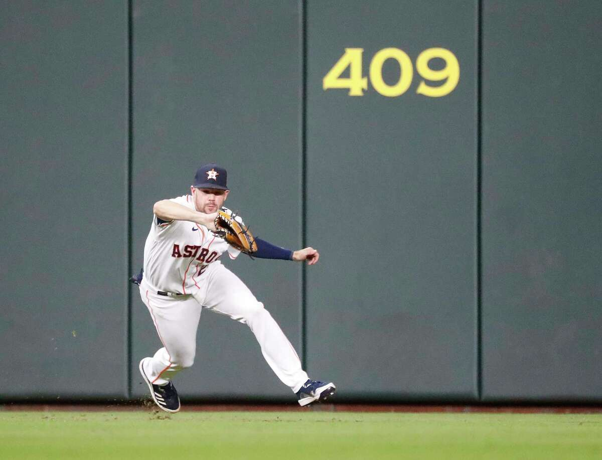 Houston Astros center fielder Chas McCormick (20) catches Colorado Rockies Sam Hilliard's lone out during the fifth inning at Minute Maid Park, Wednesday, August 11, 2021, in Houston.